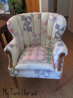 Chair covered in old patchwork quilt