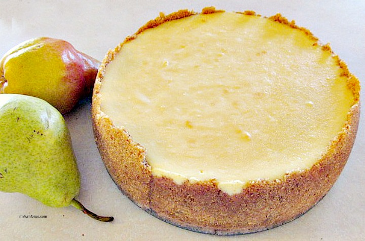 baked cheesecake before adding pear and pecan glaze
