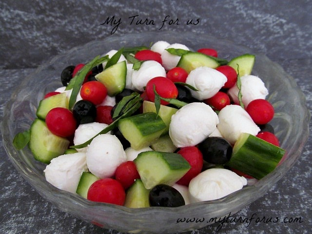 Mozzarella Cheese with black olives and tomatoes in a great summer salad