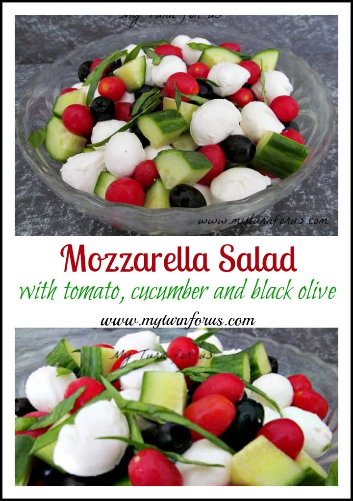 Mozzarella cheese in a summer salad with tomatoes, cucumbers and black olives