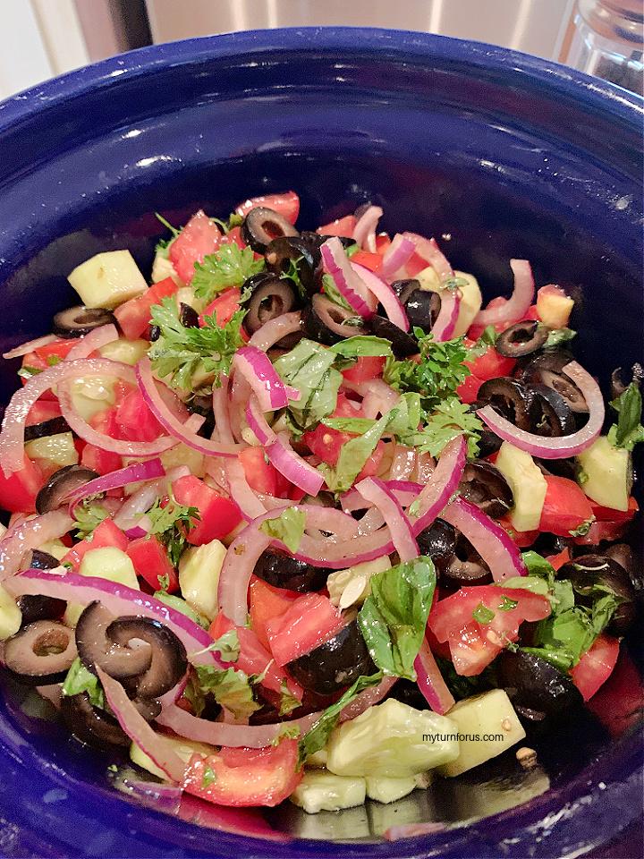 tossing the garden vegetable salad
