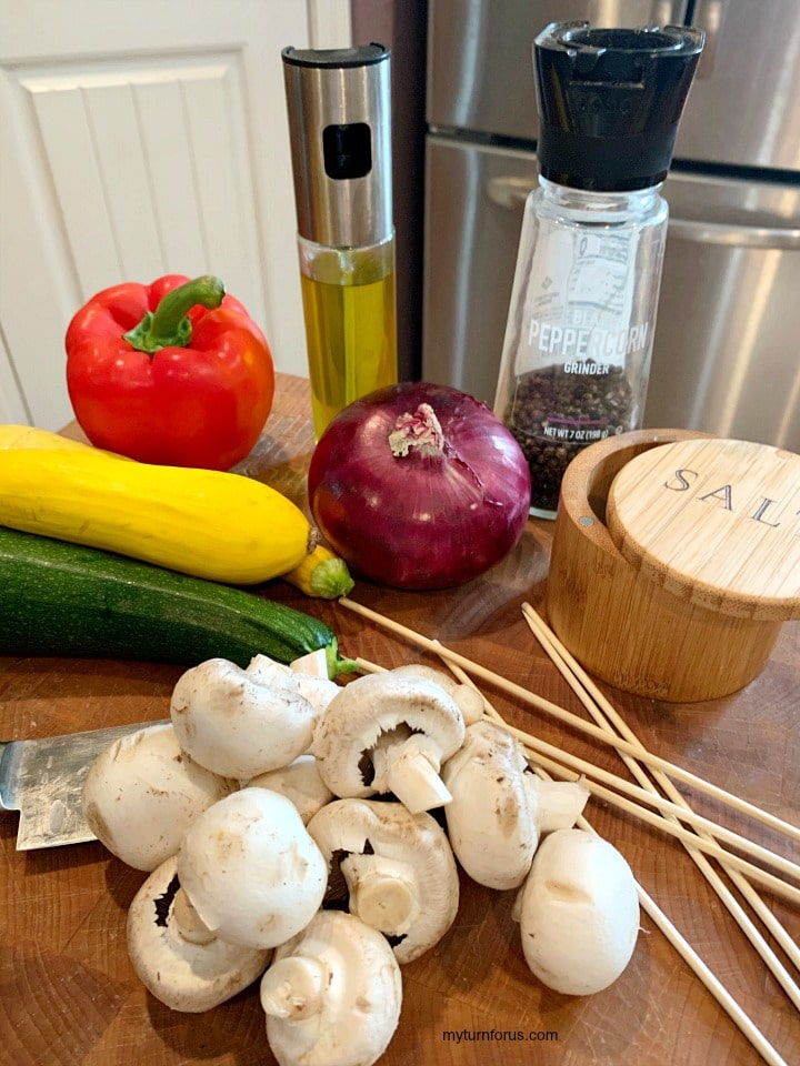 veggie for skewers, bell pepper, purple onion, mushrooms, zucchini, yellow squash and skewers