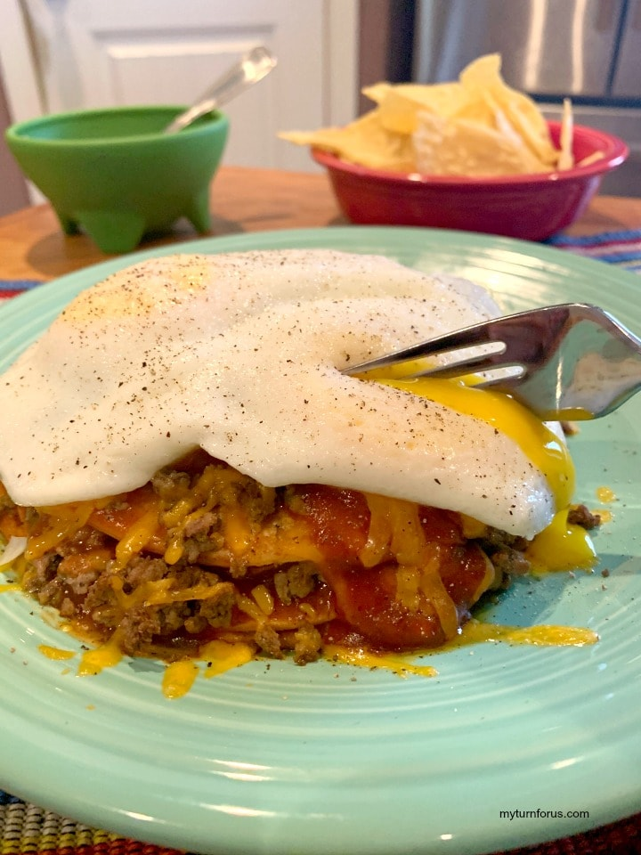 Enchiladas Chihuahua Style, Stacked Enchiladas, red stacked enchiladas with a fried egg