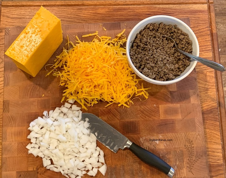 stacked enchiladas, ingredients for stacked enchiladas, grated cheese, cooked ground beef and chopped onions