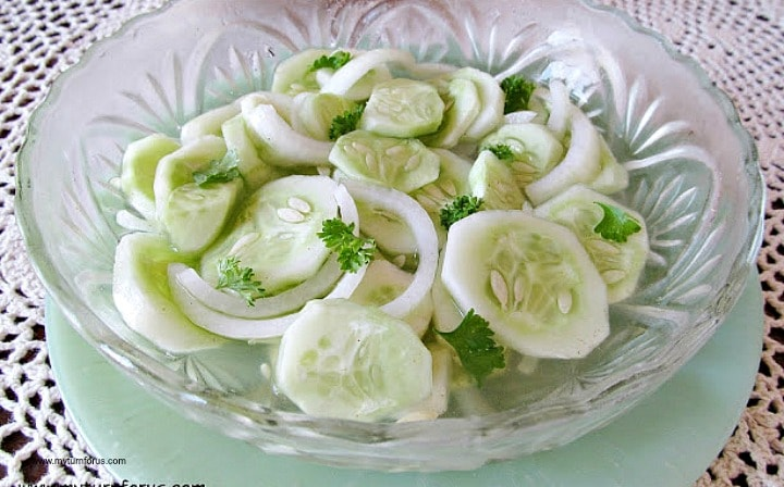 cucumbers in vinegar, sliced cucumbers and onions served in a bowl