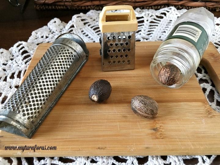 freshly ground nutmeg with nutmeg spice grater
