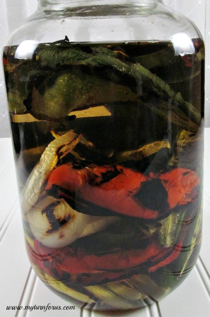 Grilled peppers and onions in vodka for spicy infused vodka