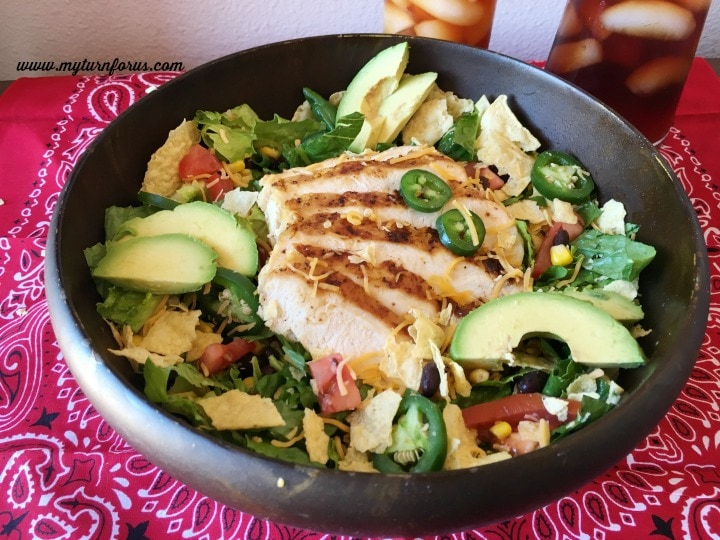 Sliced chicken on a Tex Mex Salad with avocados, jalapeños