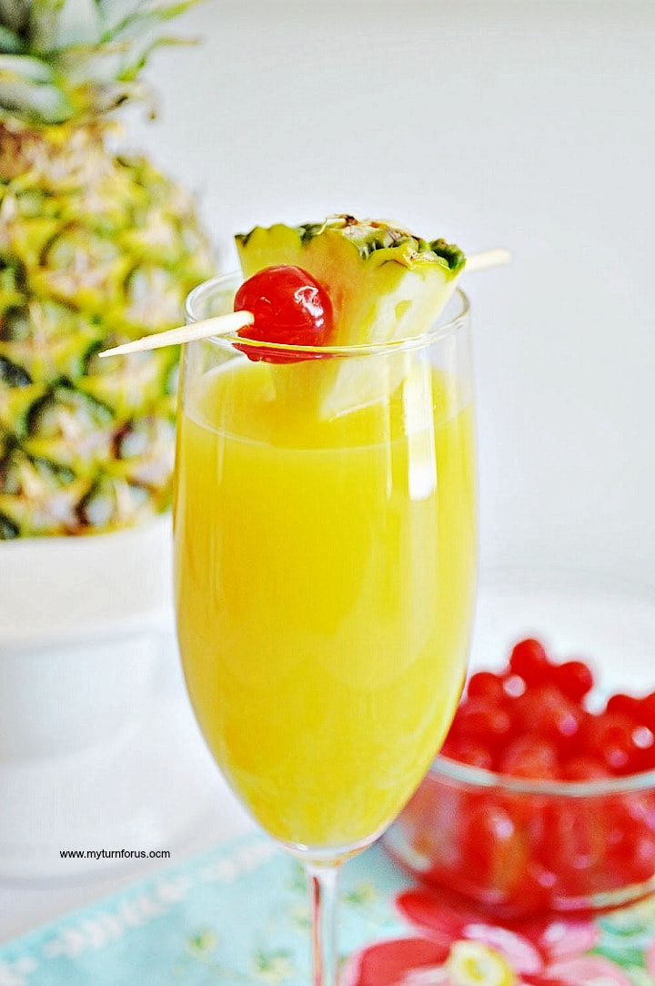 Pineapple Mimosa in a champagne glass
