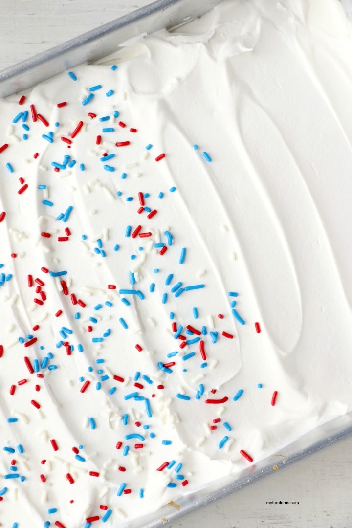 4th of July Poke Cake with Sprinkles
