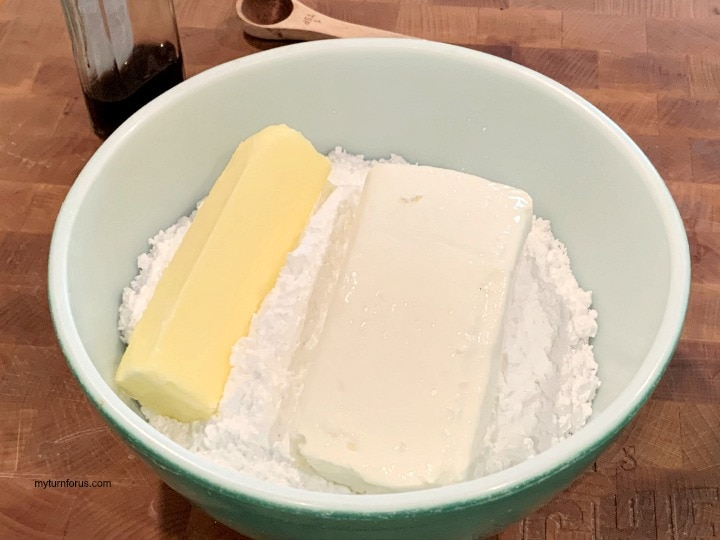 cream cheese frosting, ingredients in a bowl for cream cheese frosting