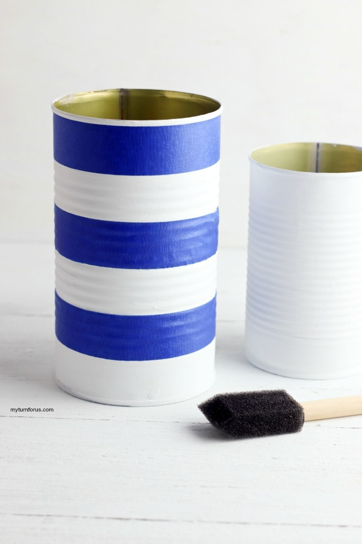 Painted can blue strips, Painted can