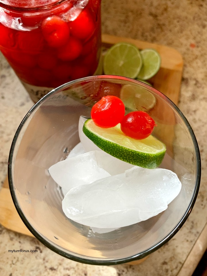 spiked cherry limeade, moonshine cherries with a slice of lime for an adult cherry limeade