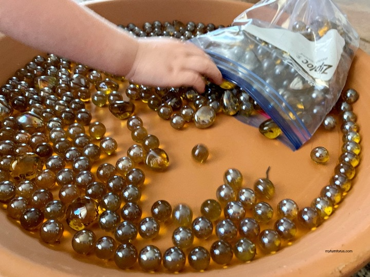 Adding Marbles to the terra cotta dish