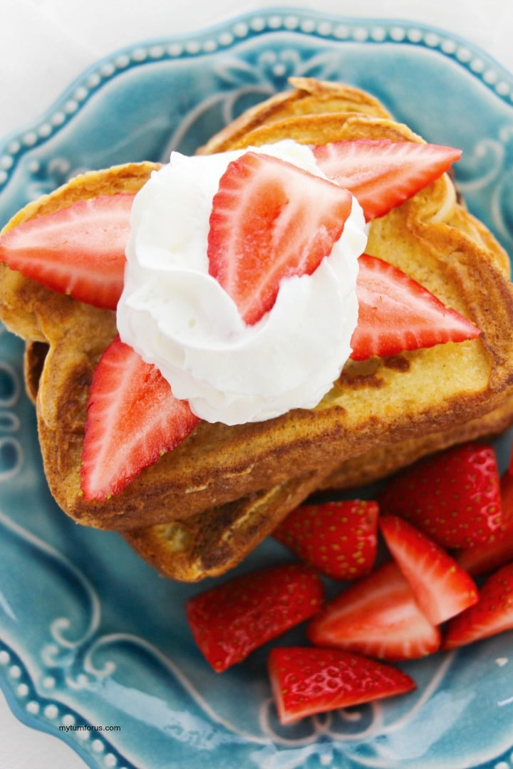 strawberries and whipped cream on cinnamon french toast