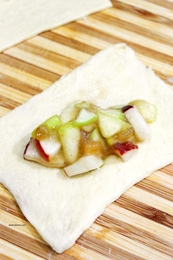 apple pie filling on squares of puff pastry dough