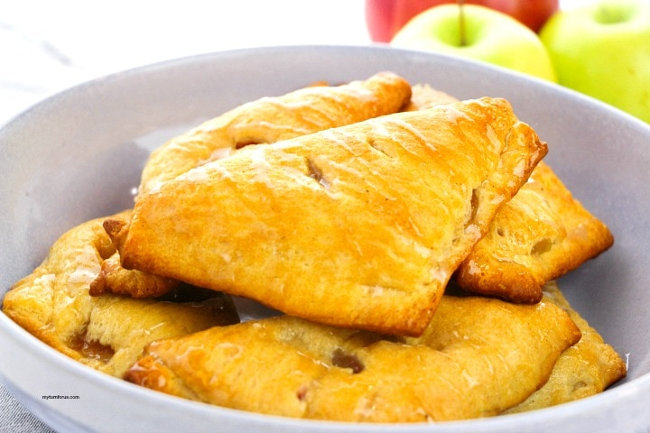 glazed apple hand pies in a bowl