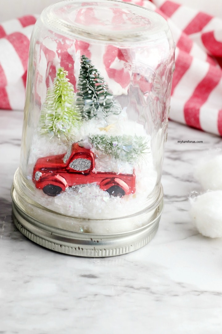 red truck christmas snow globe