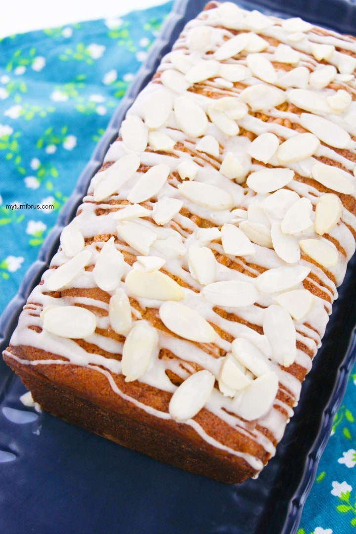 a loaf holiday eggnog bread with rum glaze and sliced almonds