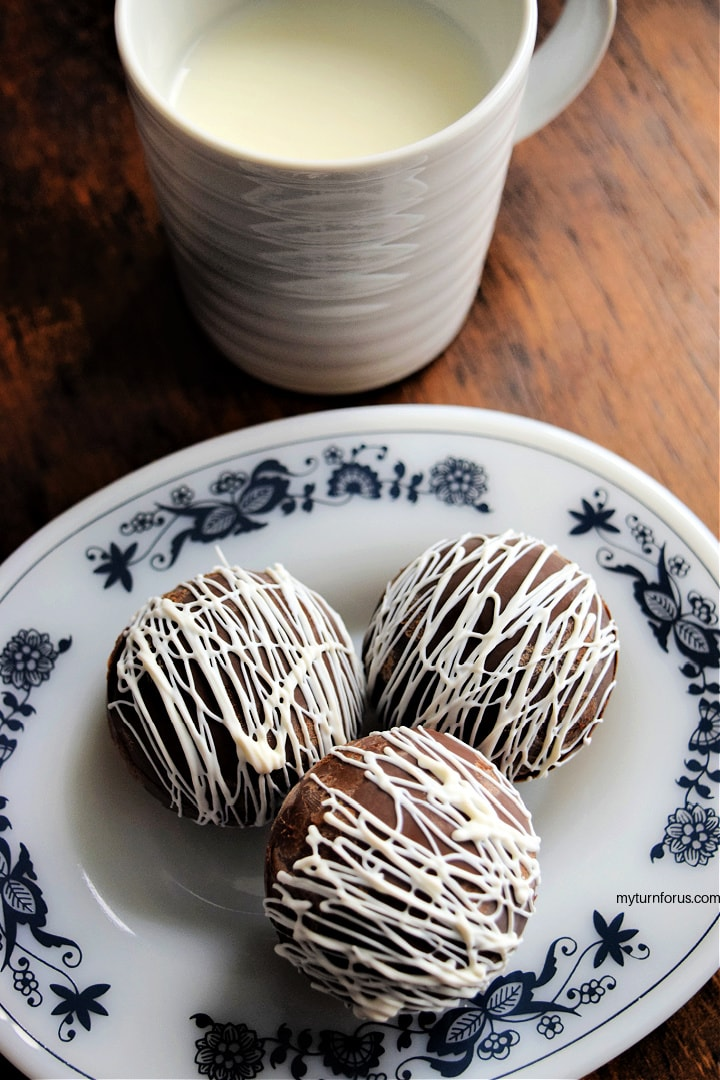 hot chocolate bombs with a cup of milk