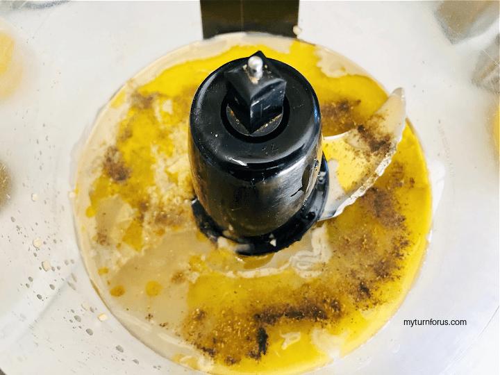 tahini, lemon juice, olive oil, garlic, and cumin in food processor