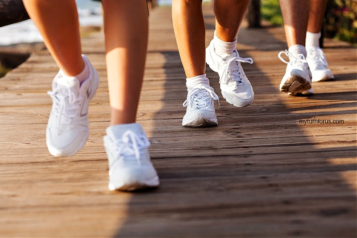 3 pairs of tennis shoes depicts walking a mile a day benefits