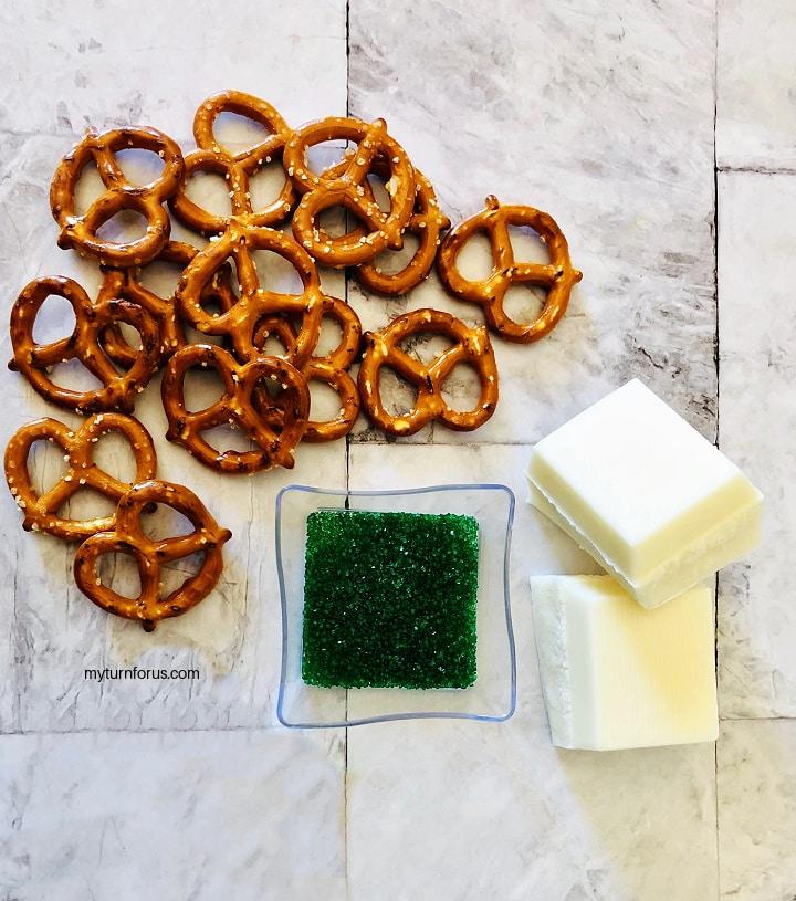 Pretzels, white chocolate, green sprinkles