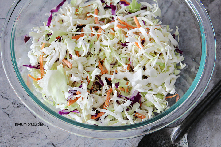shredded red and green cabbage and shredded carrots in a bowl